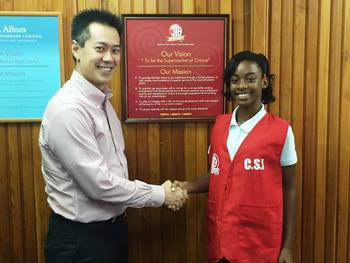 Mr. Christopher Mack (JTA Managing Director) congratulating Lilly on her promotion to JTA's CSI team